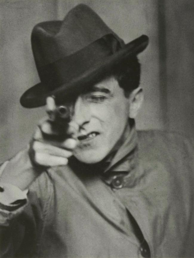 Berenice Abbott (American, 1898-1991) 'Jean Cocteau with Gun, Paris' c. 1926