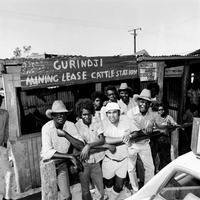 Mervyn Bishop (Australian, b. 1945) 'Bishop and Gurindji men outside the Murramulla Social Club' 1975