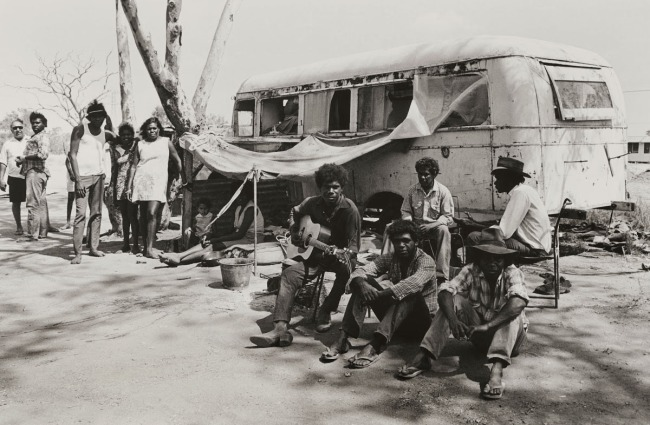 Mervyn Bishop (Australian, b. 1945) 'The bus stop, Yalambie Reserve, Mt Isa' 1974, printed 2008