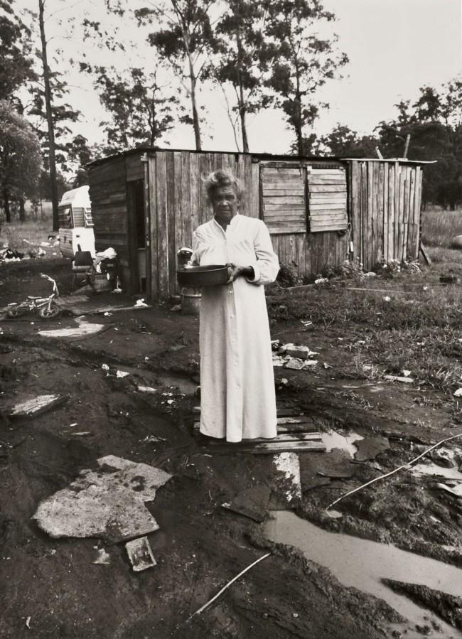 Mervyn Bishop (Australian, b. 1945) 'Woman standing near electric power cord in water, Burnt Bridge' 1988, printed 2008