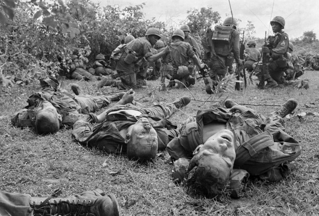 Henri Huet (French, 1927-1971)/AP'Bodies of US paratroopers lie near a command post during the battle of An Ninh' 18 September 1965