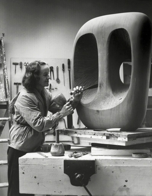 Val Wilmer. 'Barbara Hepworth in the Palais de la Danse studio, St Ives, at work on the wood carving 'Hollow Form with White Interior'' 1963