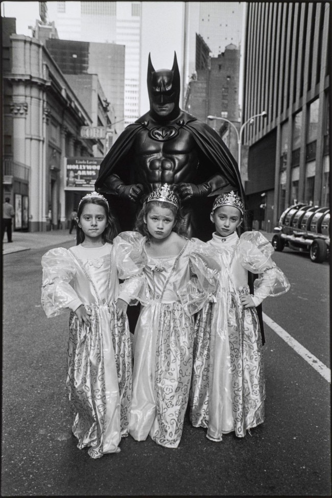 """Mary Ellen Mark (American, 1940-2015) 'Batman and Little Barbies at the Toys """"R"""" Us Holiday Parade, New York' 2002 (printed later)"""