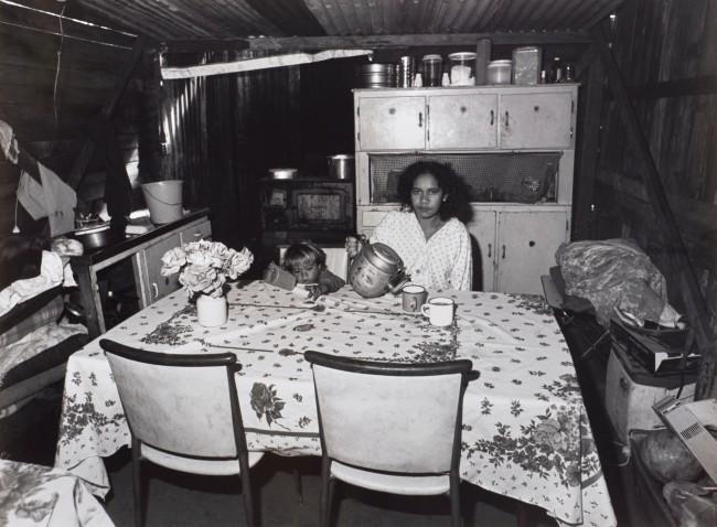 Mervyn Bishop (Australian, b. 1945) 'Girl pours tea, Burnt Bridge' 1988