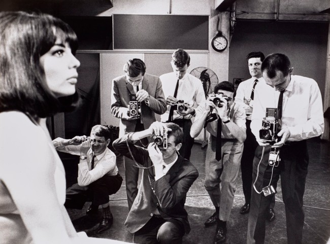 Mervyn Bishop (Australian, b. 1945) 'Photography cadets with model, Sydney Morning Herald' 1967