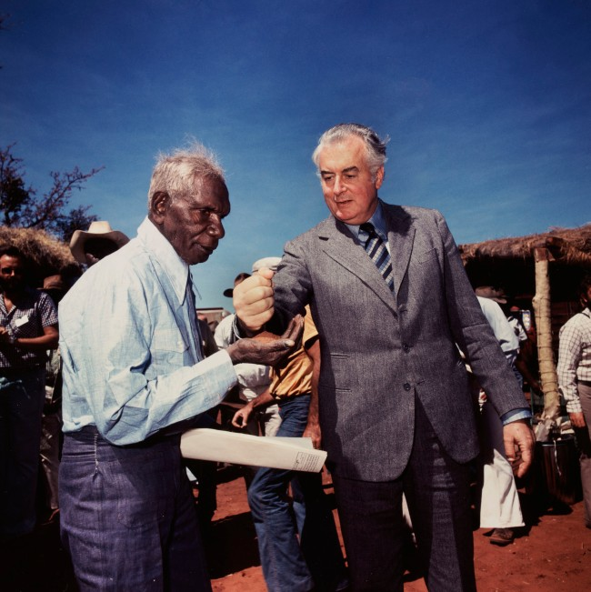 Mervyn Bishop (Australian, b. 1945) 'Prime Minister Gough Whitlam pours soil into the hands of traditional land owner Vincent Lingiari, Northern Territory' 1975, printed 1999