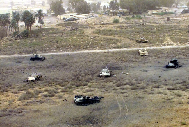 MSGT Howard J. Farrell, US Marine Corps. 'T-54s, T-55s, Type 59s or Type 69s at Diwaniyah, Iraq' 16 April 2003