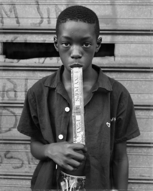 Dawoud Bey (American, b. 1953) 'A Boy Eating a Foxy Pop, Brooklyn, NY' 1988, printed 2019