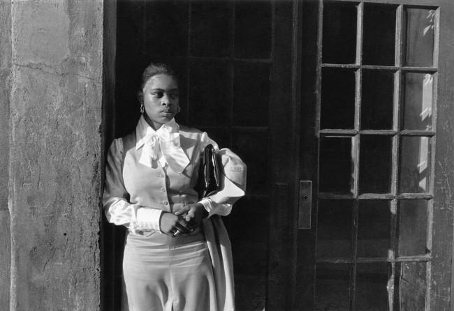 Dawoud Bey (American, b. 1953) 'A Woman Waiting in the Doorway, Harlem, NY' 1977, printed 2019