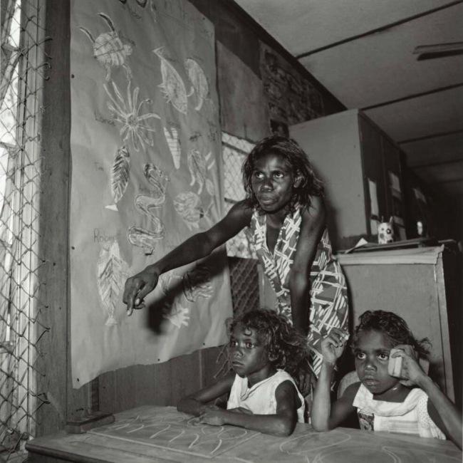 Mervyn Bishop (Australian, b. 1945) 'An Aboriginal school teacher and two children, Maningrida community, Arnhem Land, Northern Territory' 1975, reproduction 2014