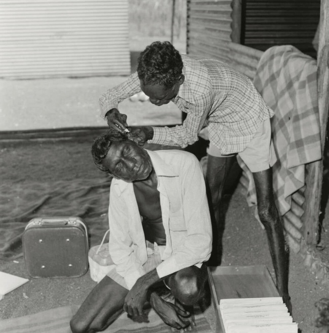 Mervyn Bishop (Australian, b. 1945) 'John Nykamula treating patient Gurrumuru Mala, Arnhemland, Northern Territory' 1975, reproduction 2014