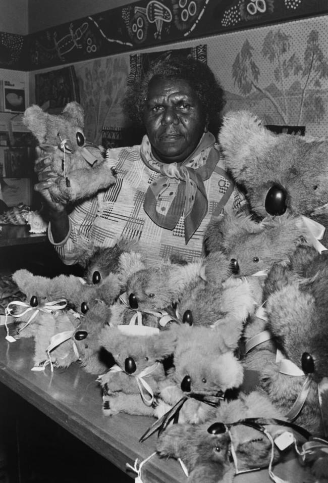Mervyn Bishop (Australian, b. 1945) 'Melba Saunders surrounded by stuffed koalas at an Aboriginal craft shop, Brisbane' 1974, reproduction 2014