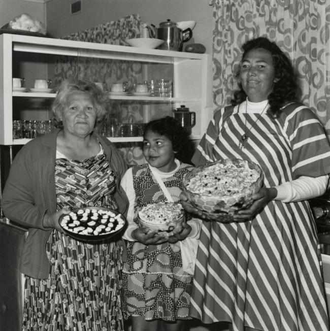 Mervyn Bishop (Australian, b. 1945) 'Three Aboriginal women holding cakes, Mungundi, New South Wales' 1976, reproduction 2014