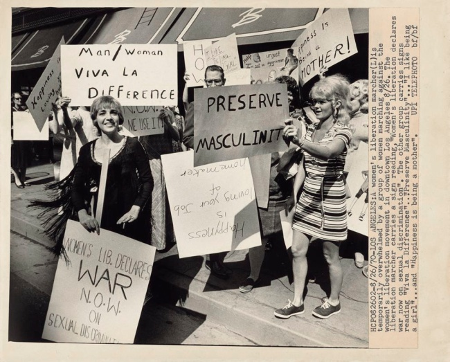Robert Flora (American, 1929-1986) 'A Women's Liberation Marcher Is Temporarily Overwhelmed by a Group of Women Marching against the Women's Liberation Movement in Downtown Los Angeles' August 26, 1970