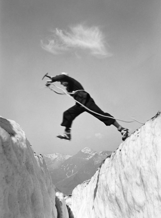 Ernst A. Heiniger (Swiss, 1909-1993) 'Jumping over a crevasse, Bernese Oberland' 1933