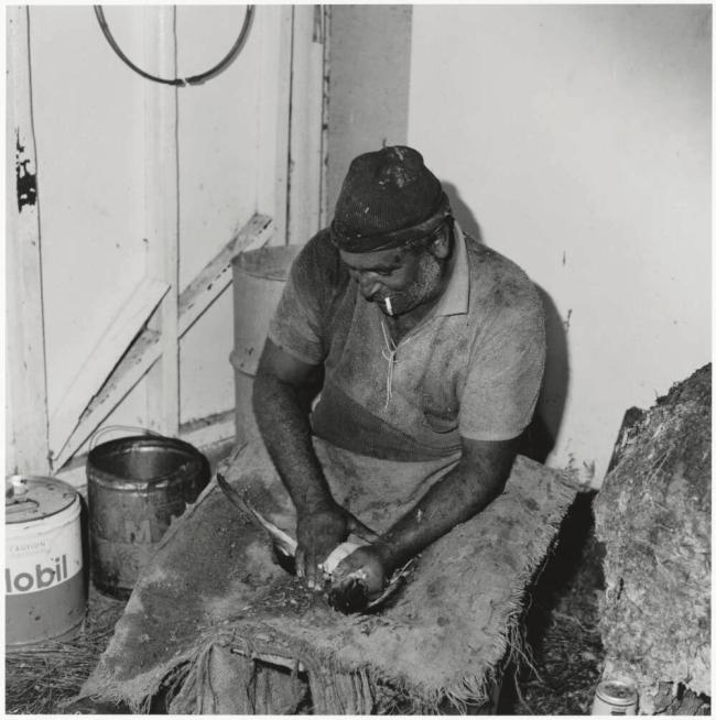 Mervyn Bishop (Australian, b. 1945) 'Eric Maynard cleaning a mutton bird, Great Dog Island, Tasmania' 1975, reproduction 2014