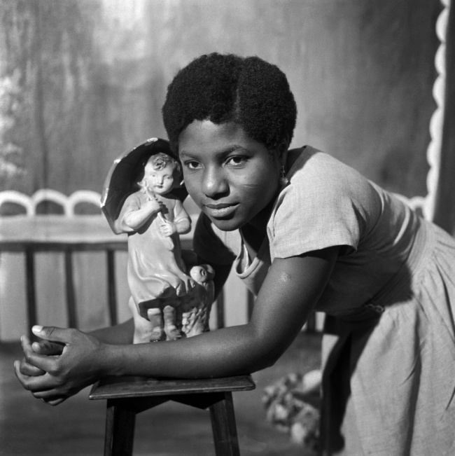 James Barnor (Ghanian, b. 1929) 'Beatrice with trademark figurine, Ever Young Studio, Accra' c. 1953